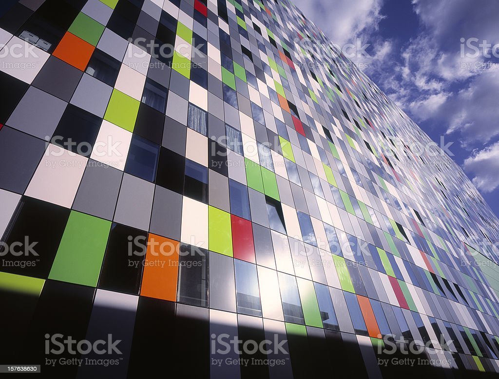 Colorful wall office building with reflection of sky. royalty-free stock photo