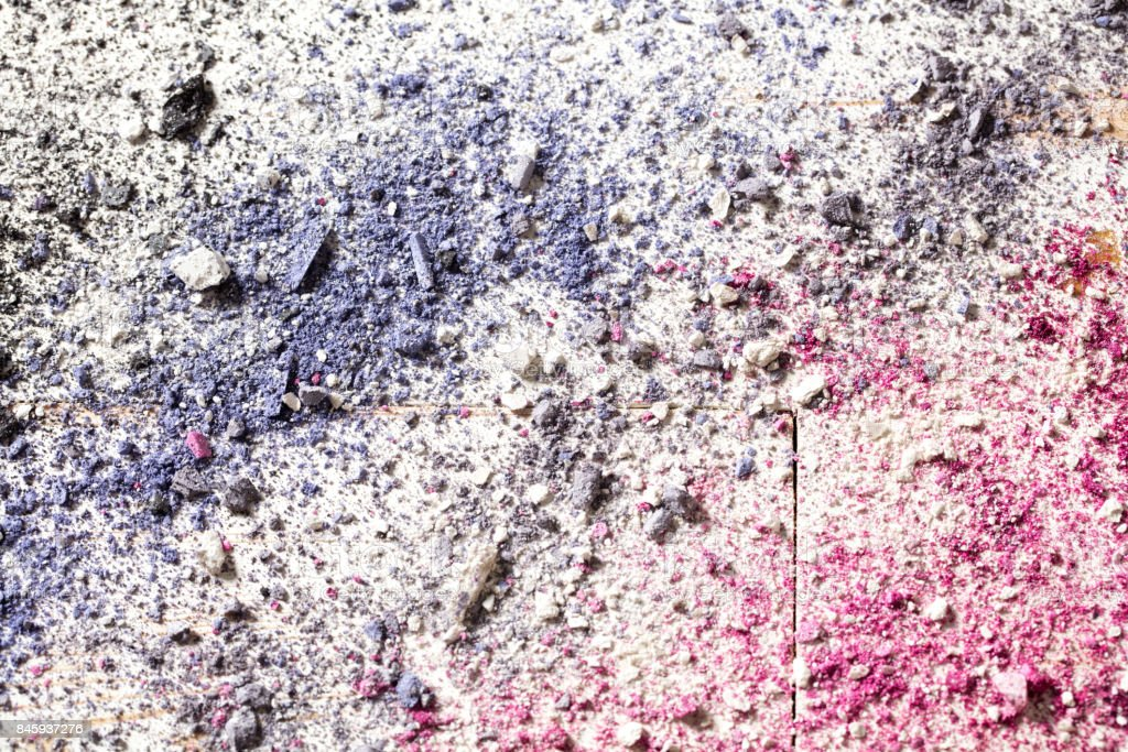 Colorful wallpaper with crushed eye fashion makeup on white wood stock photo