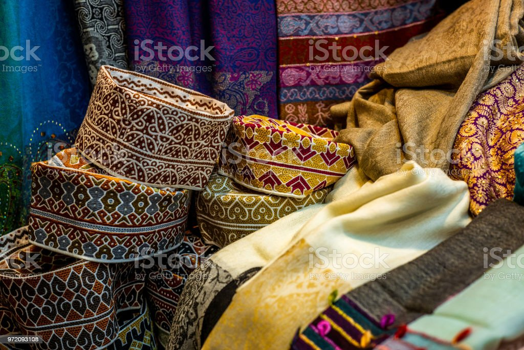 Colorful wares on sale in a traditional Omani Suq (Market) in Muscat - 10 stock photo