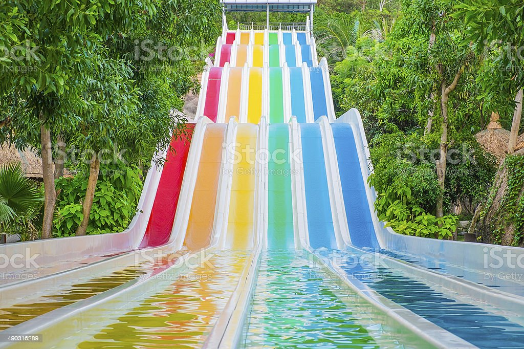 Colorful waterslides in water park stock photo