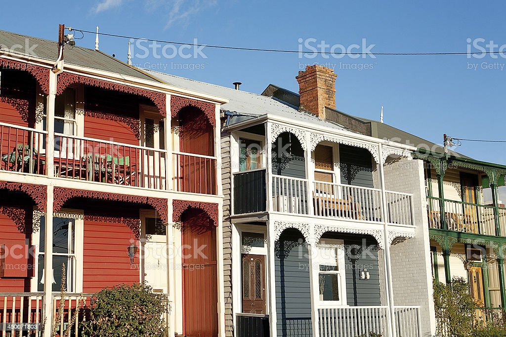 Colorful weatherboard on different homes on the street stock photo