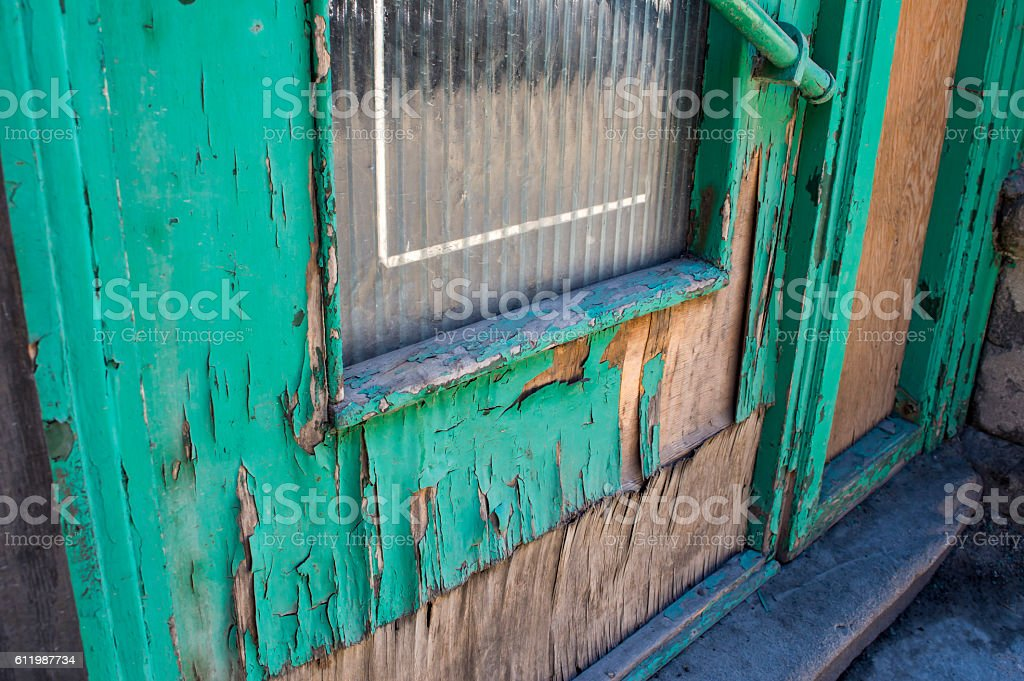 Colorful Weathered Old Door wood exposed. stock photo