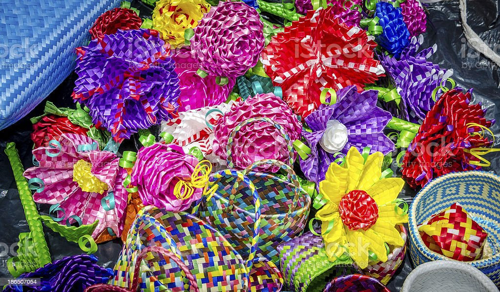 Colorful weaved baskets and flowers royalty-free stock photo