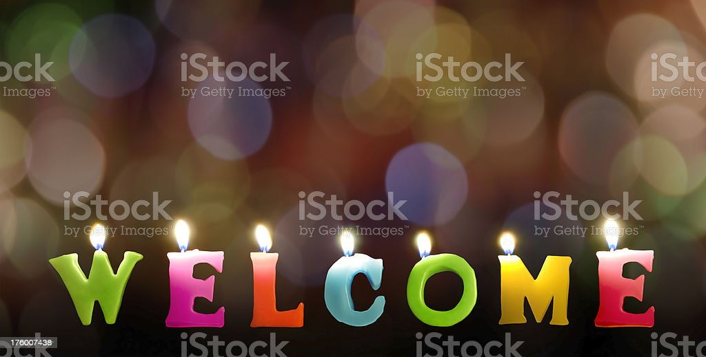 Colorful Welcome candles with rainbow bokeh blackground royalty-free stock photo