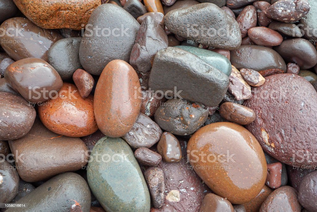 Colorful wet beach stones on Lake Superior, closeup stock photo