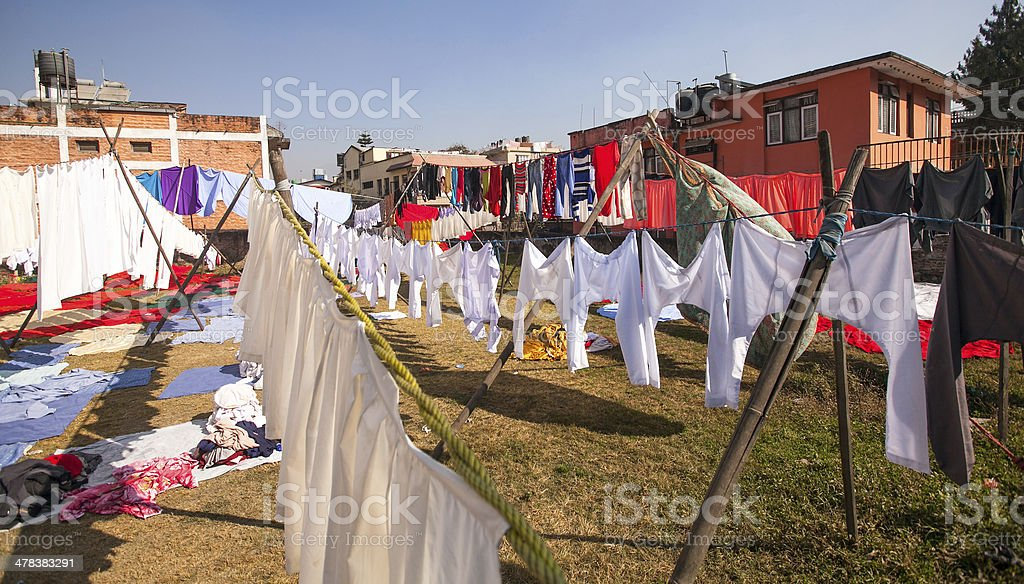 Colorful wet clothes washed in Kathmandu stock photo