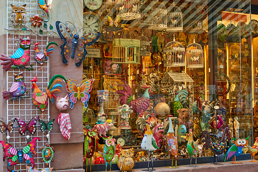 Colorful window display of souvenir shop in Colmar old town
