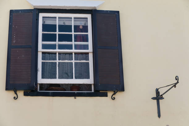 Colorful window & shutters stock photo