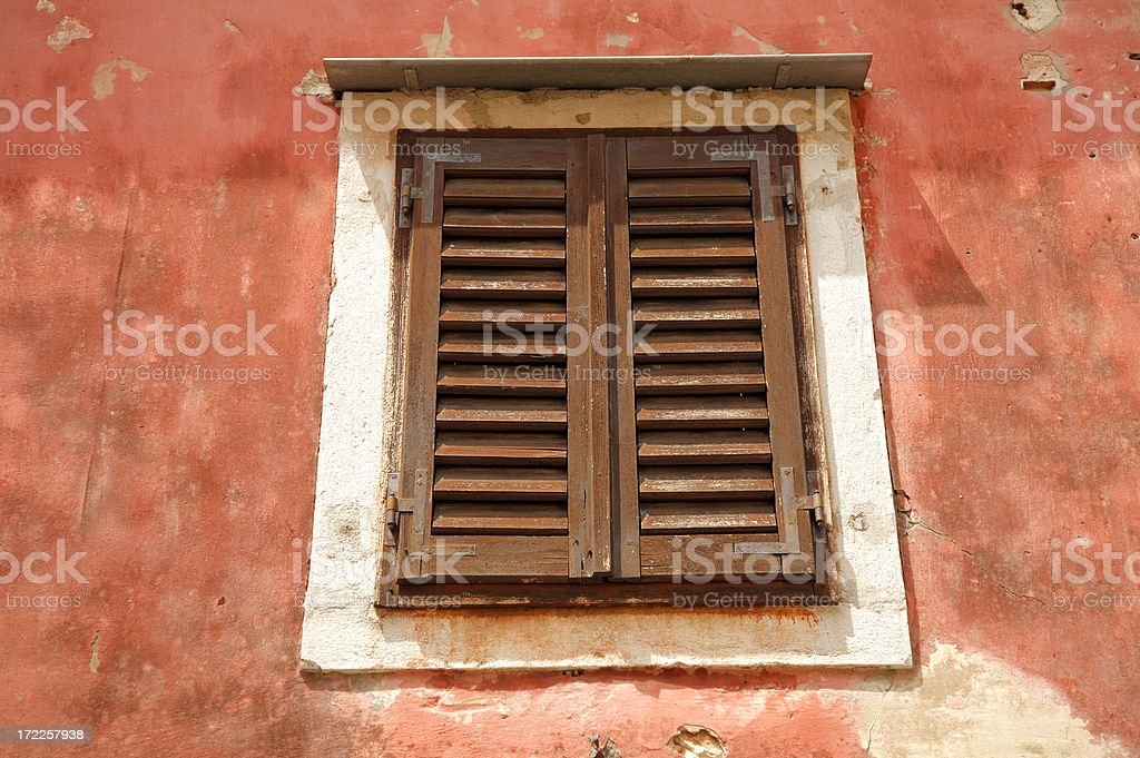 Colorful window with shutters in Europe. stock photo