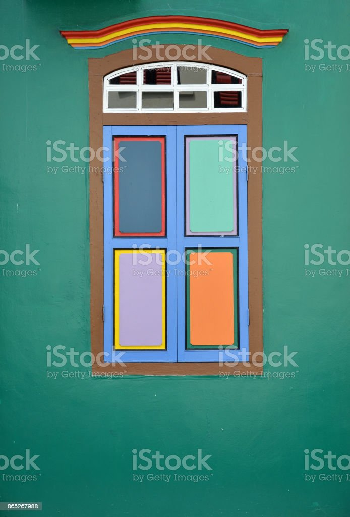 Colorful windows and details on a colonial house stock photo