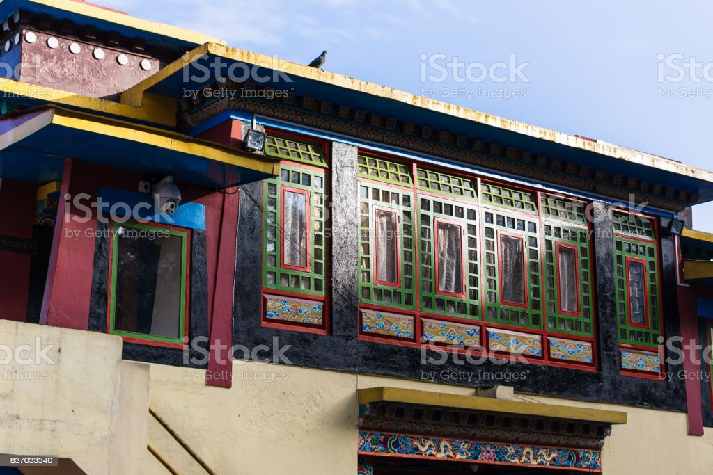 Colorful windows detail with sunlight of Rumtek Monastery in winter near Gangtok. Sikkim, India. stock photo