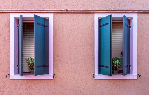 colorful windows in Burano, Italy