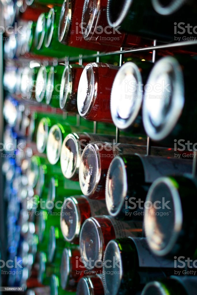 Colorful Wine Bottles in a Rack - Full Frame royalty-free stock photo