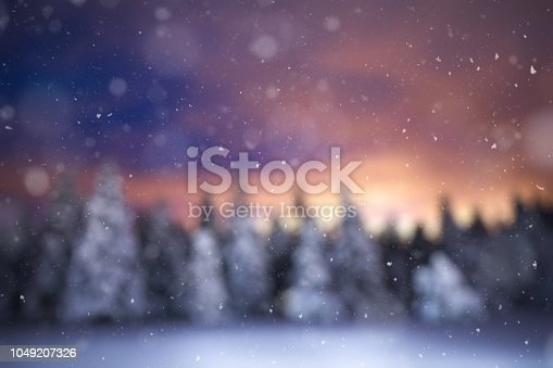 Defocused winter background with falling snow.