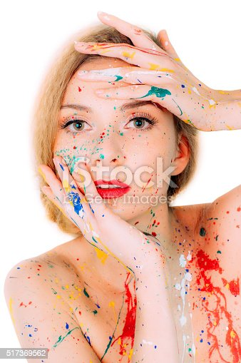 860245894istockphoto Colorful woman portrait in paint  with hands near the eyes 517369562