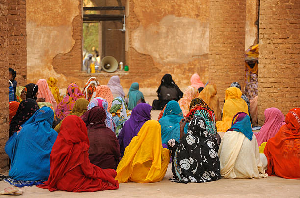 colorful women during prayer in mosque, kassala, sudan - sudan stock photos and pictures