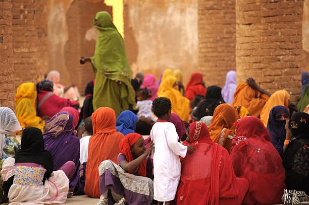 Colorful women during prayer in mosque, Kassala, Sudan stock photo