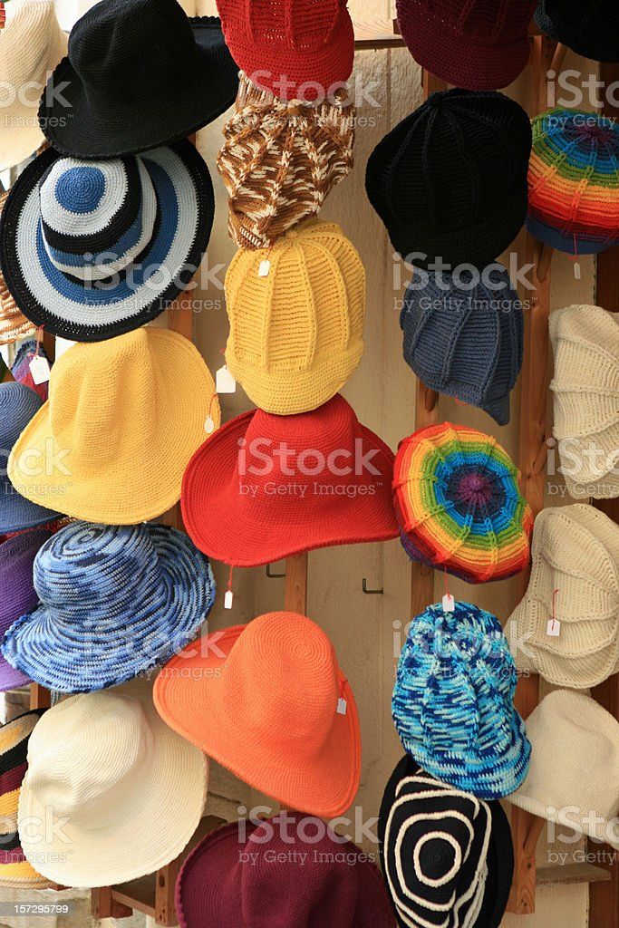 Colorful women's summer hats for sale at French shop stock photo