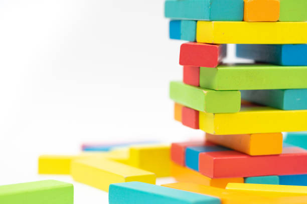 Colorful wood blocks stack game on the table with copy-space, background concept stock photo