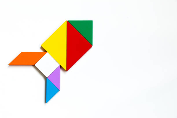 colorful wood tangram puzzle in rocket or missile shape on white background - rocket logo stock photos and pictures