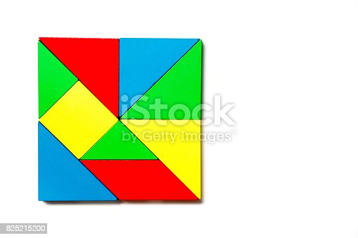 istock Colorful wood toy puzzle in geometric square shape on white background 825215200