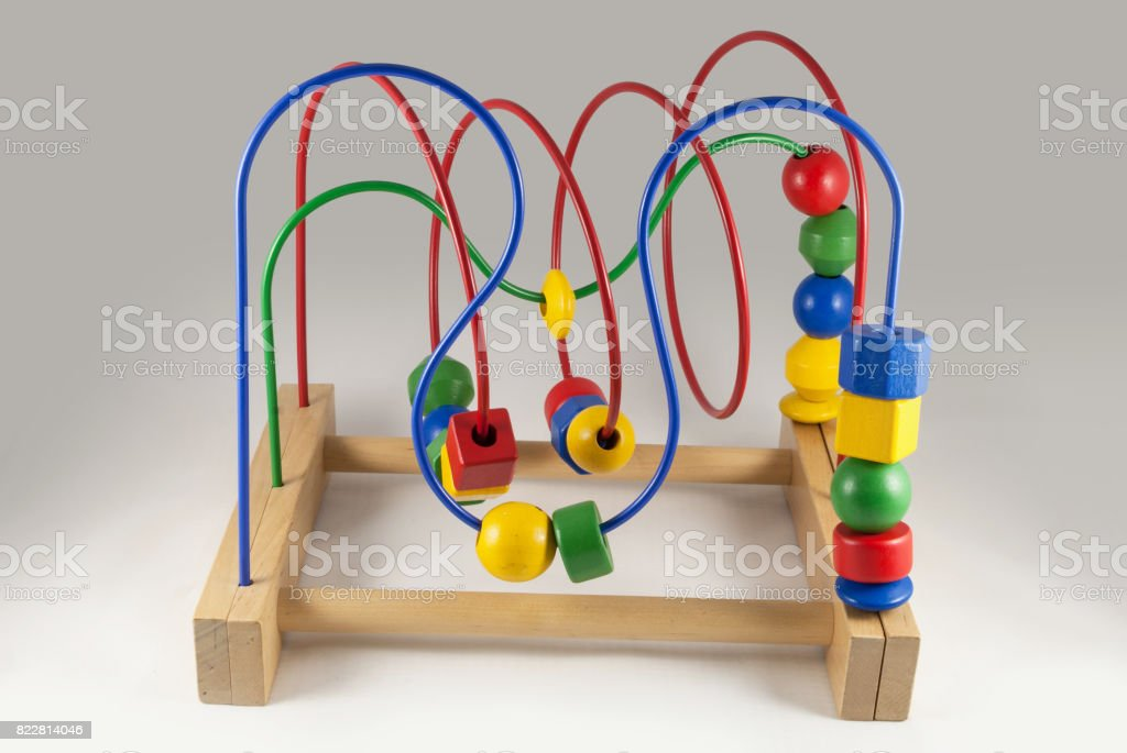 Colorful wooden bead roller coaster toy stock photo