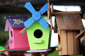 colorful wooden bird house background.