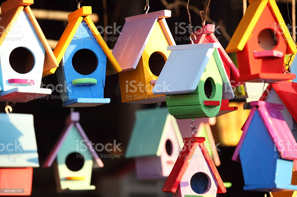colorful wooden bird house stock photo