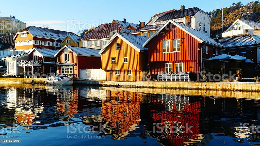Colorful wooden buildings over fjord stock photo