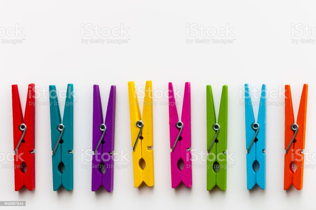 Colorful wooden clothespins on white background with copy space/diversity concept stock photo