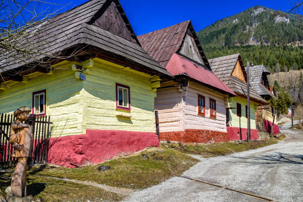 Colorful wooden cottages in village Vlkolinec, Slovakia stock photo