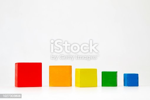 Colorful wooden cubes in a row