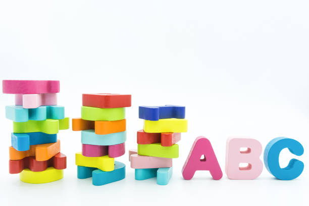 Colorful wooden educational abc toy puzzle for kids. stock photo