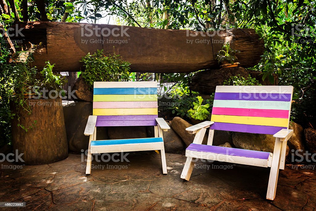 Colorful Wooden Lawn Chairs In The Spring Garden Stock Photo Download Image Now Istock