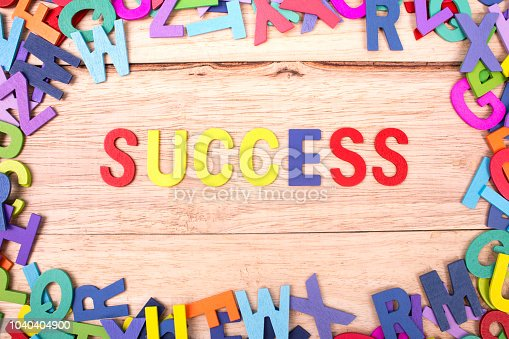 istock colorful wooden letter of the alphabet and the word SUCCESS isolated on wood background 1040404900