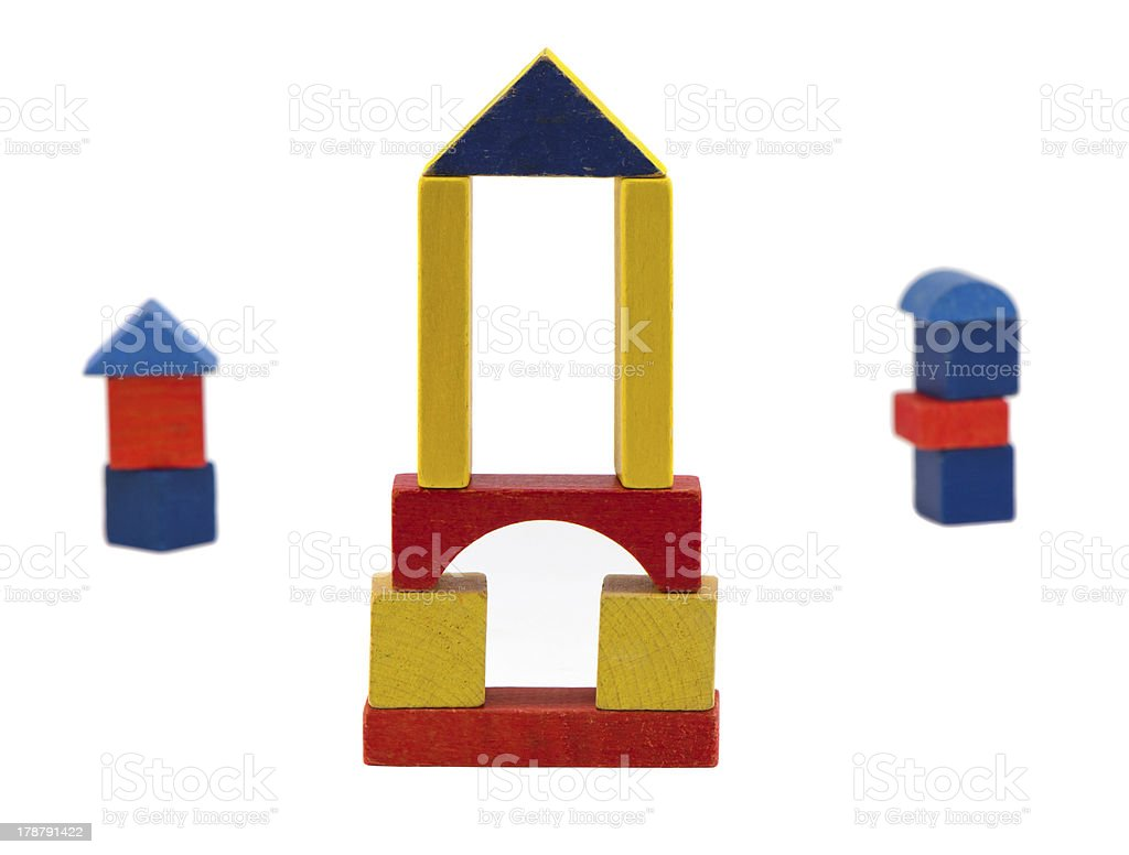Colorful wooden log toy stand isolated on white royalty-free stock photo