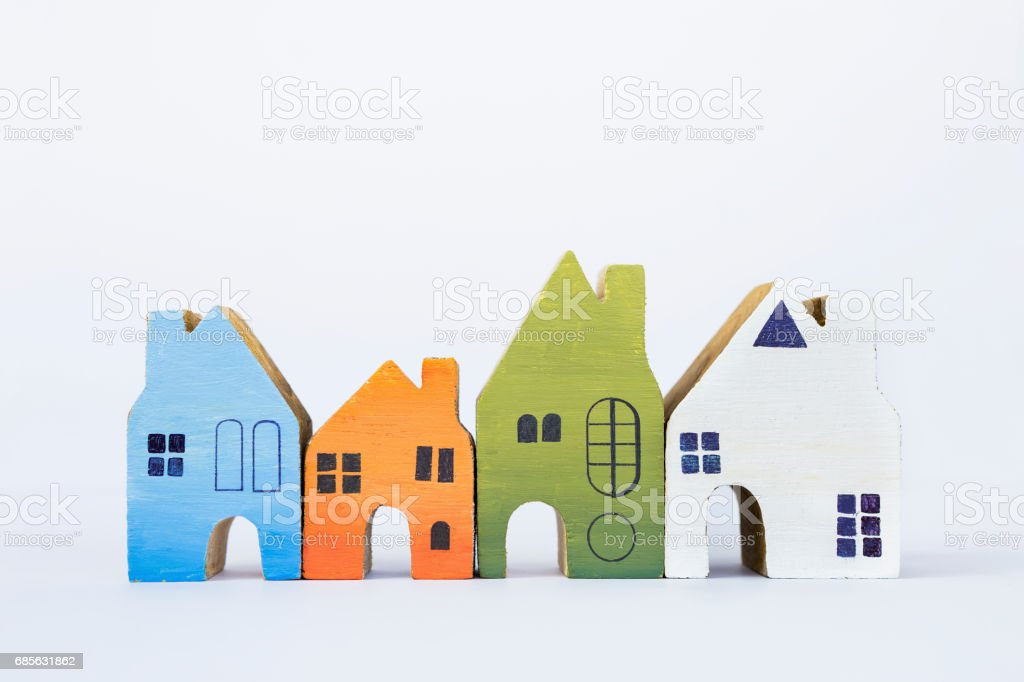 Colorful wooden miniature house on white background foto de stock royalty-free