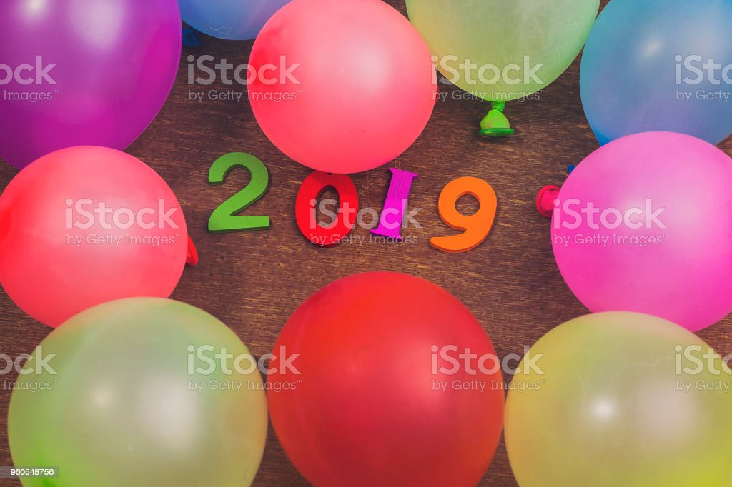 colorful wooden numbers forming the number 2019 with ballons , For the new year 2019 stock photo