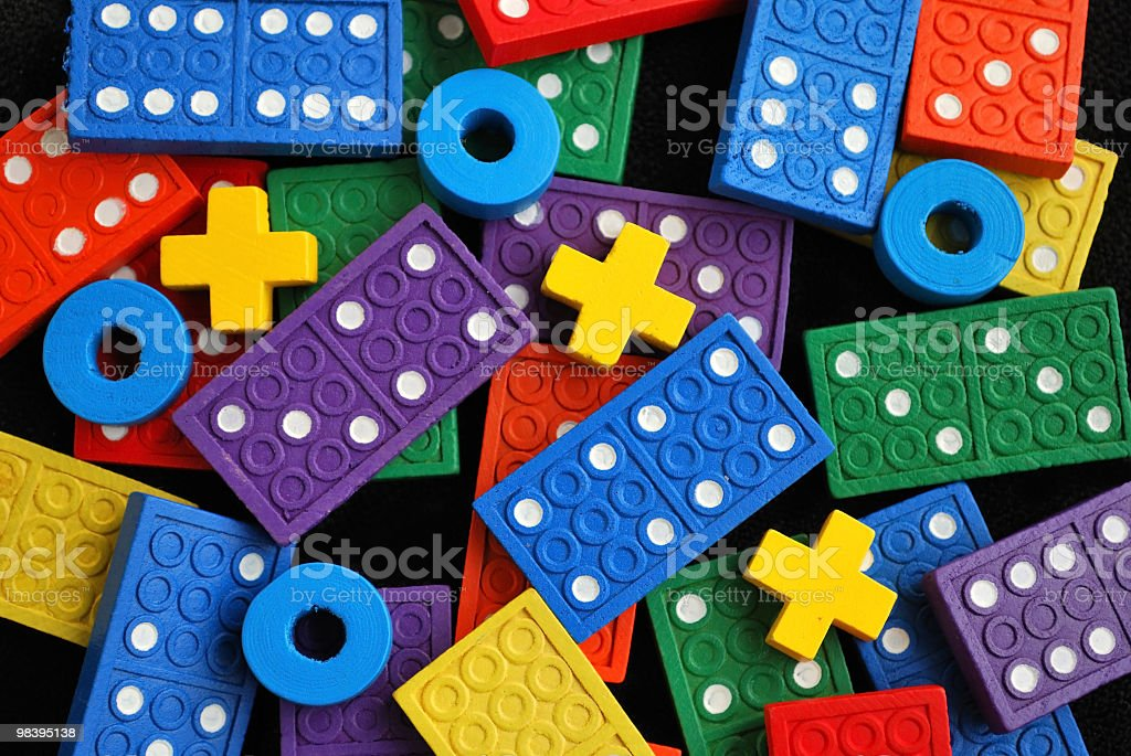 "Colorful Wooden ""X""s and ""O""s with Dominoes Background royalty-free stock photo"