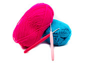 Colorful wool with crochet hooks isolated