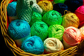Colorful woolen balls in a basket