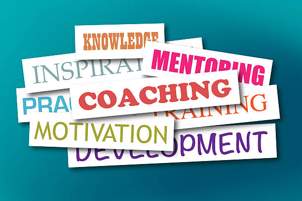 Colorful word cloud about coaching on a blue background stock photo