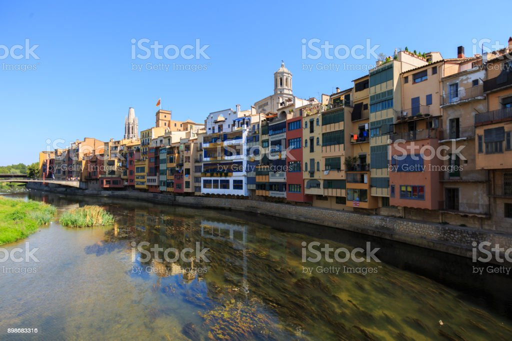 Colorful yellow and orange houses in Gerona stock photo