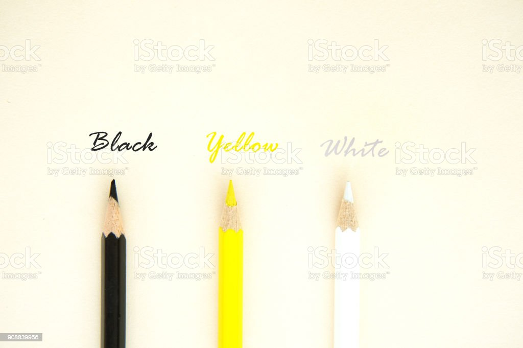 colorful yellow black white pencil color with text letter for human skin equity concept background stock photo