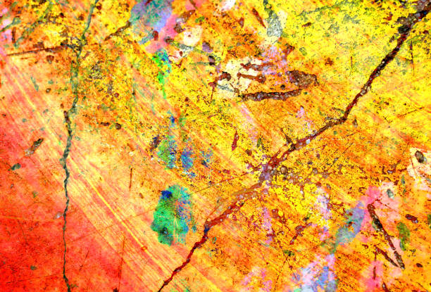 colorful yellow ,brown,pink and green grunge concrete wall paint abstract texture background stock photo