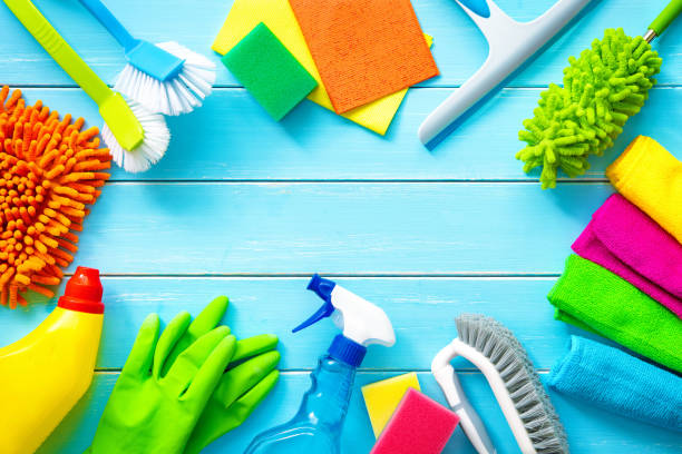 Colorfull cleaning items on blue wooden stock photo