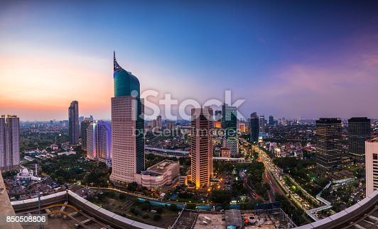 colorfull Jakarta Skyline at dawn with the iconic building. The building is one of the most highest building in Indonesia.