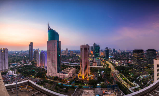 colorfull Jakarta Skyline at dawn colorfull Jakarta Skyline at dawn with the iconic building. The building is one of the most highest building in Indonesia. indonesia stock pictures, royalty-free photos & images