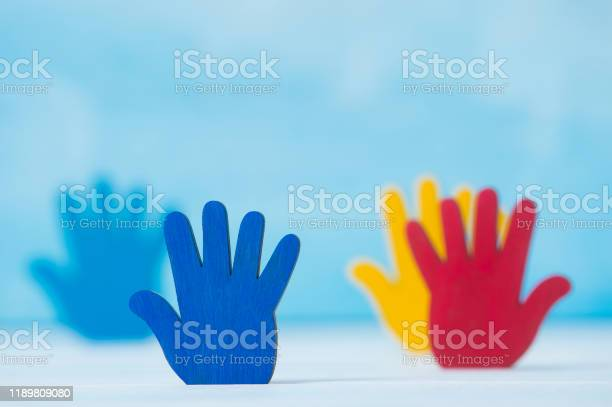 Colorfull puzzles hands on blue background world autism awareness day picture id1189809080?b=1&k=6&m=1189809080&s=612x612&h=ew enjuhxxvxvc amg9uj0zsxzx qpcshlbfpu3nkfi=