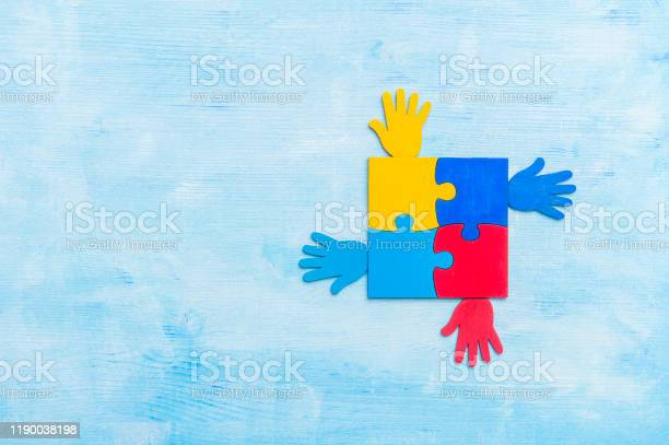 Colorfull puzzles piece and hands on blue background world autism picture id1190038198?b=1&k=6&m=1190038198&s=612x612&h=p1tikqrc2 ttkhp52gbbjao8vzsddmcnzq4gyzzze4w=